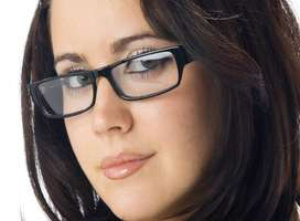 Studious dark-haired young woman with glasses