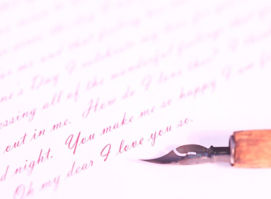 A handwritten letter of text with ink pen close by