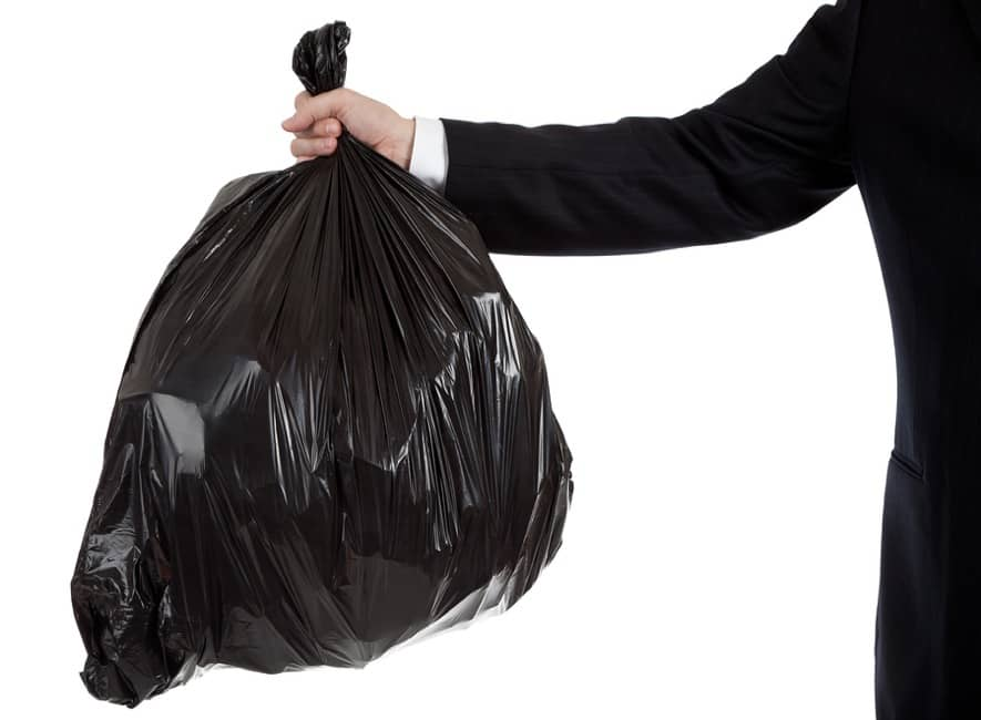 Man holding a full trash bag bin liner