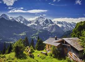 Beautiful Swiss mountain cabin landscape photo vista