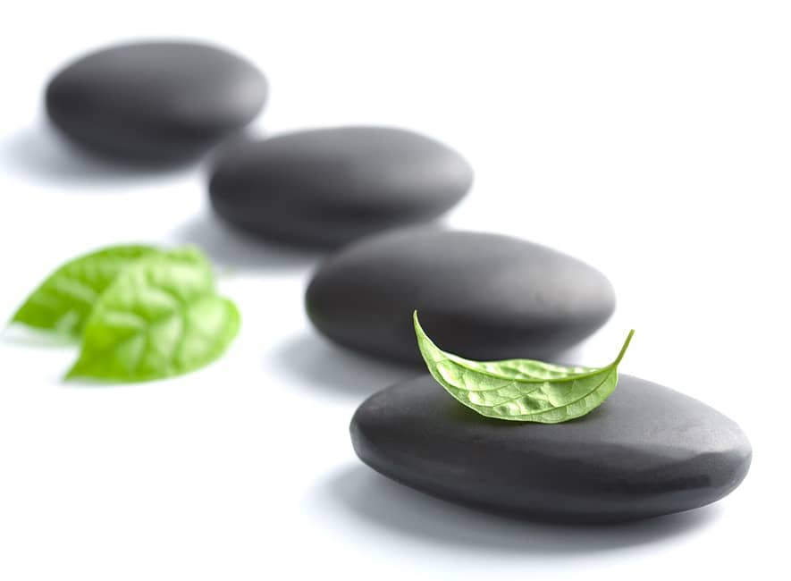 Uplifting photo of 4 black stones and 3 leaves