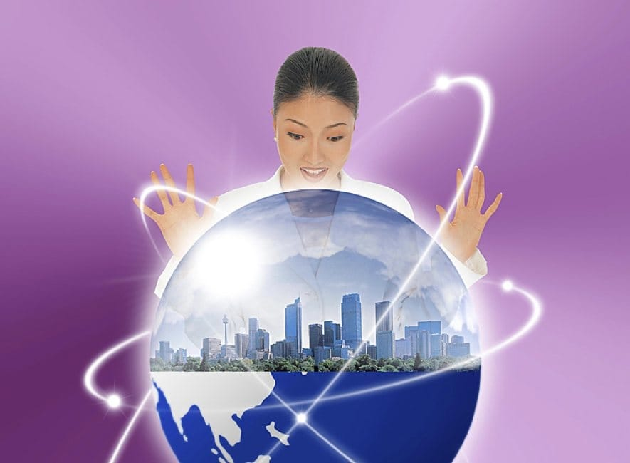 Photo illustration of girl looking at globe of Earth