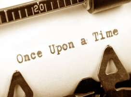 The words once upon a time on typewriter paper