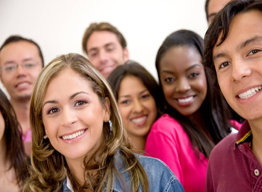 A group of multiple diverse young people smiling