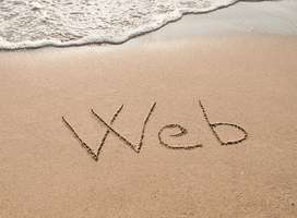 The word Web written in sand on beautiful beach