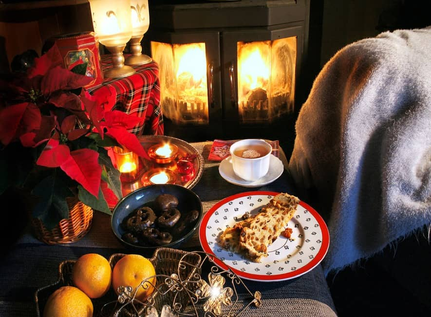 Christmas food treats, Scottish tartan, lit wood-burner fire