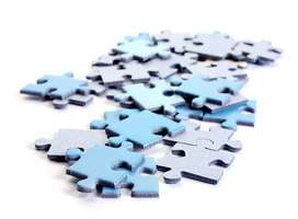 An assortment pile of jig-saw puzzle pieces