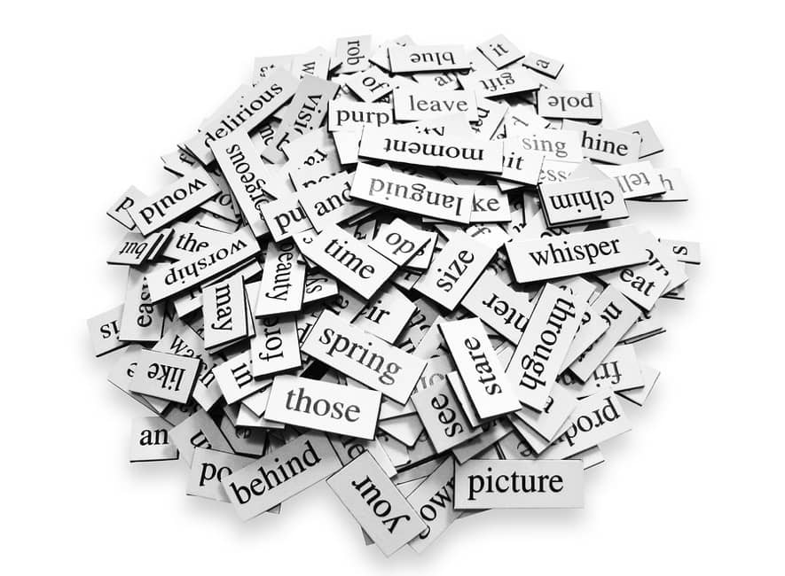 A pile of individual different printed word cut-outs